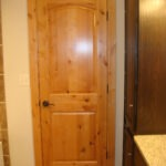 The Tongue & Groove - Knotty Alder 2 Panel Arch Door Natural Finish